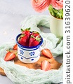 Ripe strawberries in enamel mug 31639620