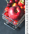 Fresh red fruit berries supermarket cart on black 31639623