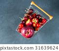 Fresh red fruit berries supermarket cart on black 31639624