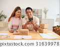 Smiling Asian Couple Planning Finances 31639978