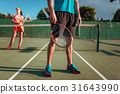 Man and woman plays tennis on open air 31643990