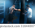 Man in black handwraps exercises with bag in gym 31644007