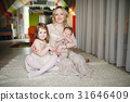 mother with daughter and son at home 31646409