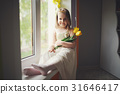 funny girl with yellow tulips at home 31646417