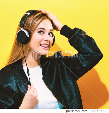 Happy young woman with headphones 31648369