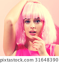 Beautiful woman in a bright pink wig 31648390