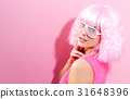 Beautiful woman in a bright pink wig 31648396