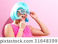 Portrait of a woman in a bright blue wig 31648399