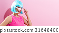 Portrait of a woman in a bright blue wig 31648400