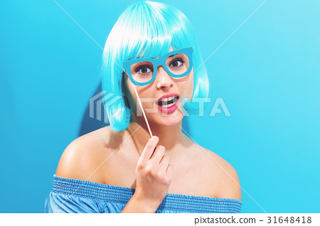 Beautiful woman in a bright blue wig 31648418