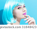 Beautiful woman in a bright blue wig 31648423