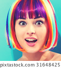 Beautiful woman in a colorful wig 31648425