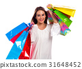 Happy young woman holding shopping bags 31648452