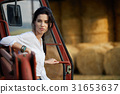 Young Female farmer and her tractor 31653637