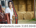 Young Female farmer and her tractor 31653648