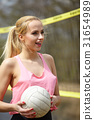 Joyful sexy blond girl playing volleyball outdoors on the lakesi 31654989