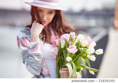 beautiful girl holds color tulips 31656345