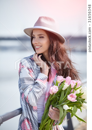 beautiful girl holds color tulips 31656348