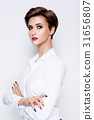 Portrait of beautiful girl with short hair 31656807