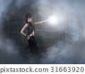 Woman in black long dress over dark background 31663920