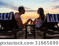 Couple holding hands on the beach of an exotic 31665699