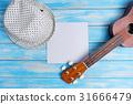 Close up of ukulele on blue wooden background 31666479