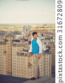 Roofer walks on the roof 31672809