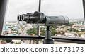 binoculars on tower 31673173