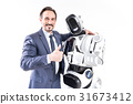 Happy smiling male person embracing cyborg 31673412