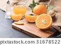 Fresh sliced orange on wood plate 31678522