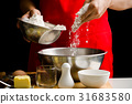 Pouring flour in a bowl for bread cooking 31683580