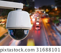 security camera with cityscape background 31688101