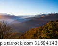 Last soft sunlight over rocky mountain peaks 31694143