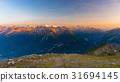Last soft sunlight over rocky mountain peaks 31694145