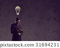 Businessman with smartphone has an idea 31694231