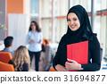 Arabian business woman with hijab holding a folder 31694877