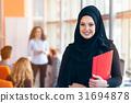 Arabian business woman with hijab holding a folder 31694878
