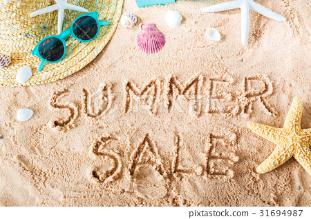 Summer Sale text in the sand 31694987