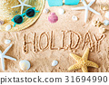 Holiday text in the sand 31694990