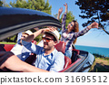 leisure, road trip, travel and people concept - 31695512