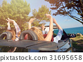 leisure, road trip, travel and people concept - 31695658