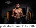 man in gym. Muscular bodybuilder guy doing 31697982