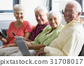 Seniors using tablets 31708017