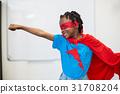 Boy pretending to be a superhero 31708204
