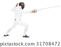 Man wearing fencing suit practicing with sword 31708472