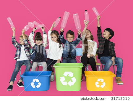 Kids and plastic bottles in a recycle bin 31712519