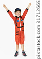 Little boy with astronaut dream job smiling 31712665