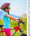 Child traveling bicycle in summer park. 31716164