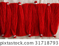 Red tassels line close up 31718793