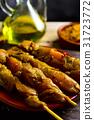 spiced chicken meat skewers 31723772